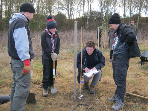 Planting an orchard on our December 2016 Task Day, assisted by Shadoxhurst Scouts.
