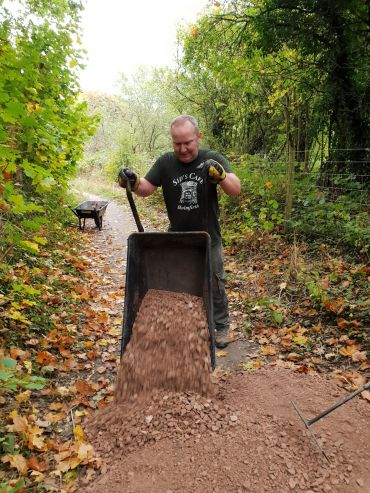 Sean unloading the wheelbarrow on Robin Path